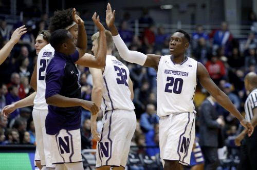 Northwestern guard/forward Scottie Lindsey (20) celebrates with teammates after scoring a basket against DePaul during the first half of an NCAA college basketball game Saturday, Dec. 3, 2016, in Evanston, Ill. (AP Photo/Nam Y. Huh)