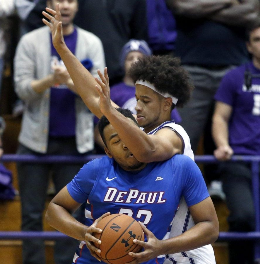 Northwestern center Barret Benson, right, guards DePaul forward Al Elchelberger during the first half of an NCAA college basketball game on Saturday, Dec. 3, 2016, in Evanston, Ill. Northwestern won 80-64. (AP Photo/Nam Y. Huh)
