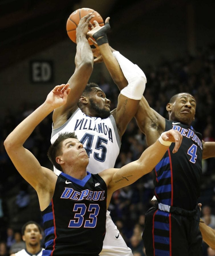 DePaul guard Brandon Cyrus (4) tries to block a shot by Villanova forward Darryl Reynolds (45) as DePaul forward Joe Hanel (33) looks up during the first half of an NCAA college basketball game, Wednesday, Dec. 28, 2016, in Villanova, Pa. (AP Photo/Laurence Kesterson)