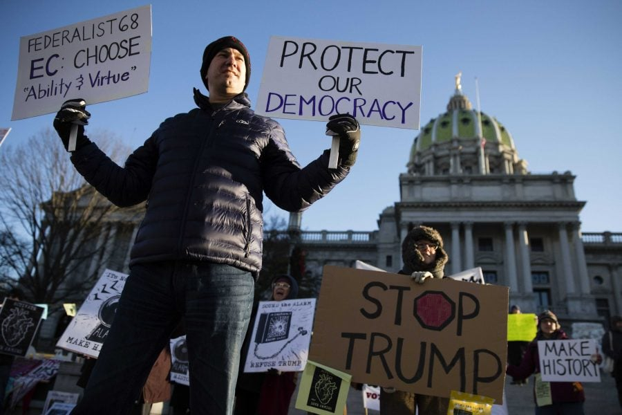 Protesters+demonstrate+ahead+of+Pennsylvania%27s+58th+Electoral+College+at+the+state+Capitol+in+Harrisburg%2C+Pennsylvania%2C+Monday%2C+Dec.+19%2C+2016.+The+demonstrators+were+waving+signs+and+chanting+in+freezing+temperatures+Monday+morning+as+delegates+began+arriving+at+the+state+Capitol+to+cast+the+state%27s+electoral+votes+for+president.+%28Matt+Rourke+%7C+AP+Photo%29