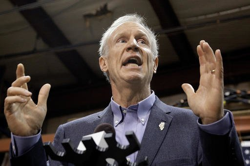 FILE - In this Nov. 16, 2016, file photo, Illinois Gov. Bruce Rauner speaks to reporters in Springfield, Ill. Rauner sent two clear signals when he dumped $50 million into his campaign fund: The 2018 race for Illinois governor will be a rough one, and the contest starts now. What's still unknown is which Democrats will try to unseat the multimillionaire former businessman. (AP Photo/Seth Perlman, File)