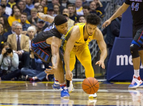 Marquette guard Markus Howard, right, and DePaul guard Devin Gage, left, fight for a loose ball during the second half of an NCAA college basketball game Saturday, Jan. 14, 2017, in Milwaukee. (AP Photo/Darren Hauck)