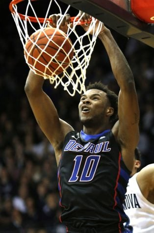 DePaul forward Tre'Darius McCallum (10) dunks during the second half of the team's NCAA college basketball game against Villanova, Wednesday, Dec. 28, 2016, in Villanova, Pa. Villanova won 68-65. (AP Photo/Laurence Kesterson)