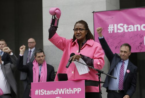 Wearing a pink boxing glove, Sen. Holly Mitchell, D-Los Angeles, called on supporters of Planned Parenthood to raise their fists in support of the organization, at the Capitol Pink Out Day 2017 rally Tuesday, Jan. 17, 2017, in Sacramento, Calif. Proponents rallied against House Speaker Paul Ryan's budget bill which would halt federal funding for Planned Parenthood. (AP Photo/Rich Pedroncelli)