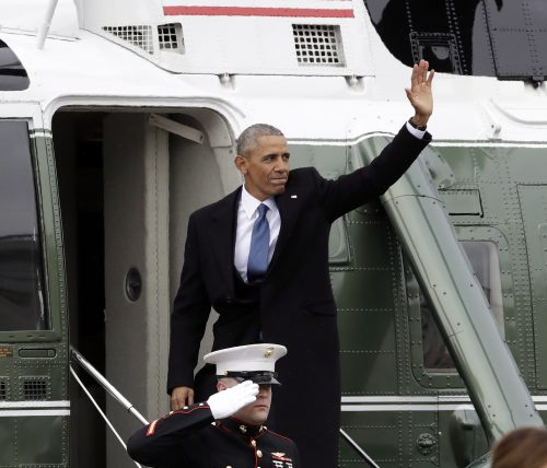 Former President Barack Obama waves as he boards a Marine helicopter during a departure ceremony on the East Front of the U.S. Capitol in Washington, Friday, Jan. 20, 2017, after President Donald Trump was inaugurated. (AP Photo/Evan Vucci)