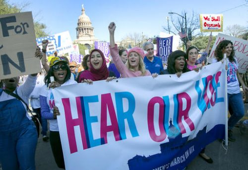 Former Texas State Senator Wendy Davis, center, dressed in pink, leads the women's movement at the Women's March on Austin to stand up for women's rights, Saturday, jan. 21, 2017, in Austin, Texas. In a global exclamation of defiance and solidarity, more than 1 million people rallied at women's marches in the nation's capital and cities around the world Saturday to send President Donald Trump an emphatic message on his first full day in office that they won't let his agenda go unchallenged. (Ralph Barrera/Austin American-Statesman via AP)