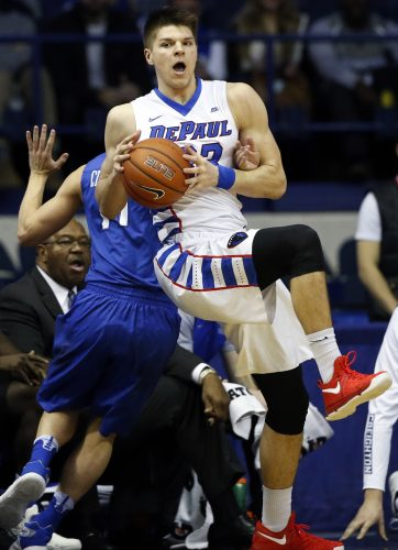 DePaul forward Joe Hanel, right, looks to pass against Creighton guard Tyler Clement during the first half of an NCAA college basketball game Saturday, Feb. 11, 2017, in Rosemont, Ill. (AP Photo/Nam Y. Huh)