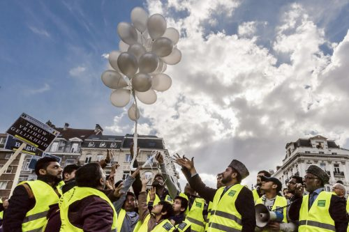 Mourners release balloons during the one-year anniversary for Brussels attacks victims at the Bourse in Brussels on Wednesday, March 22, 2017. Belgian leaders, victims and families of those who died in the suicide bomb attacks on the Brussels airport and subway are marking the first anniversary of the attacks, which killed 32 people and wounded more than 300 others. (AP Photo/Geert Vanden Wijngaert)