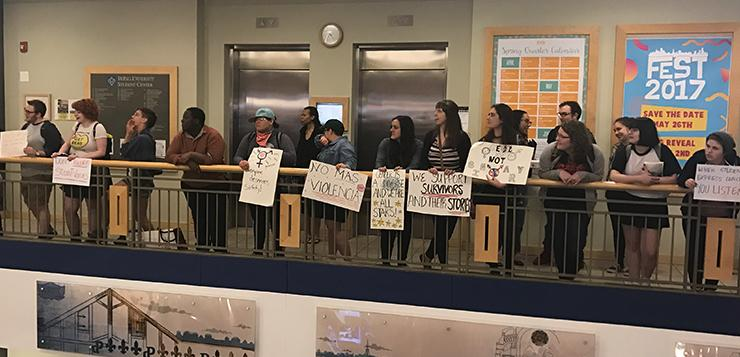 Demonstrators filed into the Student Center holding signs and repeating chants before circling up around the atrium on Thursday.