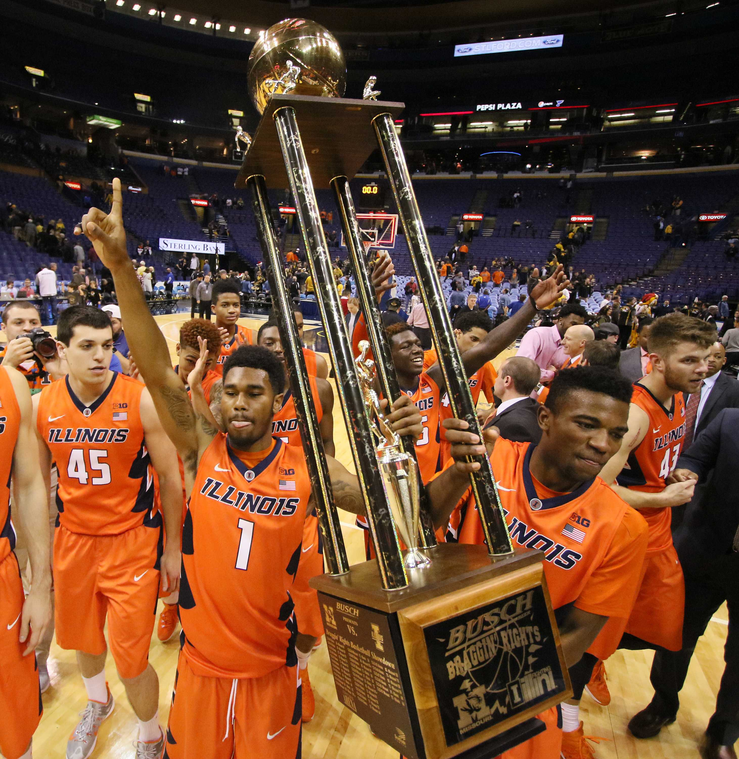 Illinois guards Jaylon Tate, left, and Aaron Jordan carry the Busch Braggin' Rights trophy, the spoils of a 69-63 win against Missouri on Wednesday, Dec. 23, 2015, at the Scottrade Center in St. Louis. Illinois won, 68-63. (Chris Lee/St. Louis Post-Dispatch/TNS)