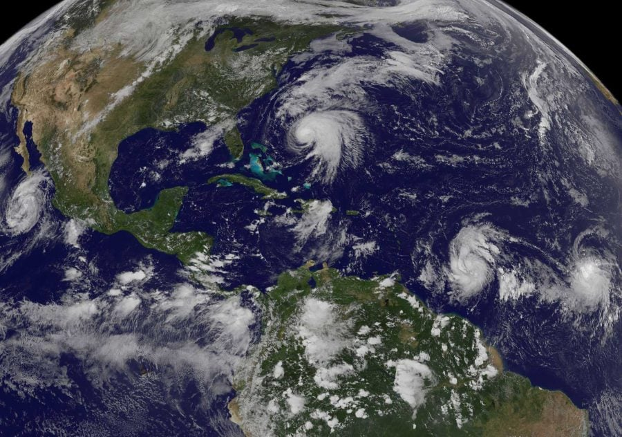 This image shows tropical weather systems Hurricane Norma, left, on the Pacific Ocean side of Mexico; Jose, center, east of Florida; Tropical Depression 15, second from right, north of South America, and Tropical Storm Lee, right, north of eastern Brazil, on Saturday, Sept. 16. (NOAA-NASA GOES PROJECT, AP)