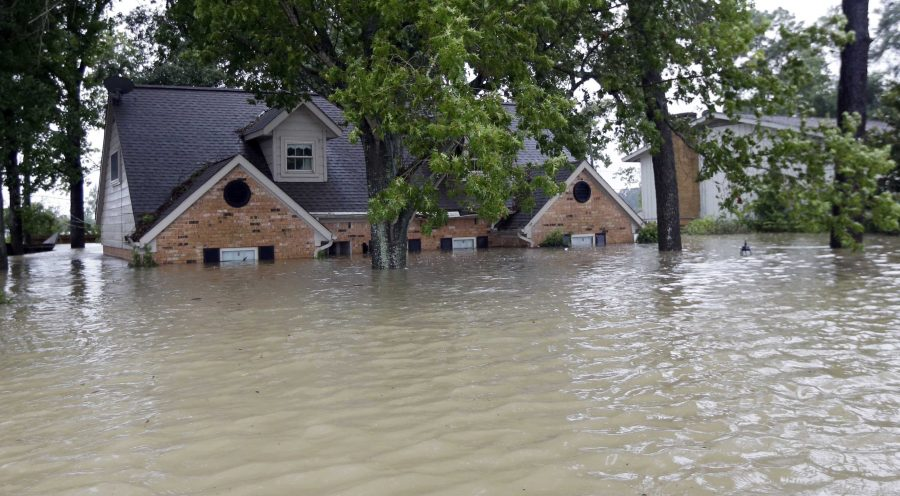 A home in Houston, Texas is submerged in severe flooding after Tropical Storm Harvey devastated south-central Texas beginning Aug. 25 when it first made landfall.    (AP Photo/David J. Phillip)