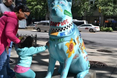 """""""Hope,"""" by Clarence Franklin is a call to end the violence that plagues Chicago. It is painted with messages of encouragement for children. On the back of """"Hope"""" is a plea to """"let our kids grow up.""""  (Benjamin Conboy/The DePaulia)"""