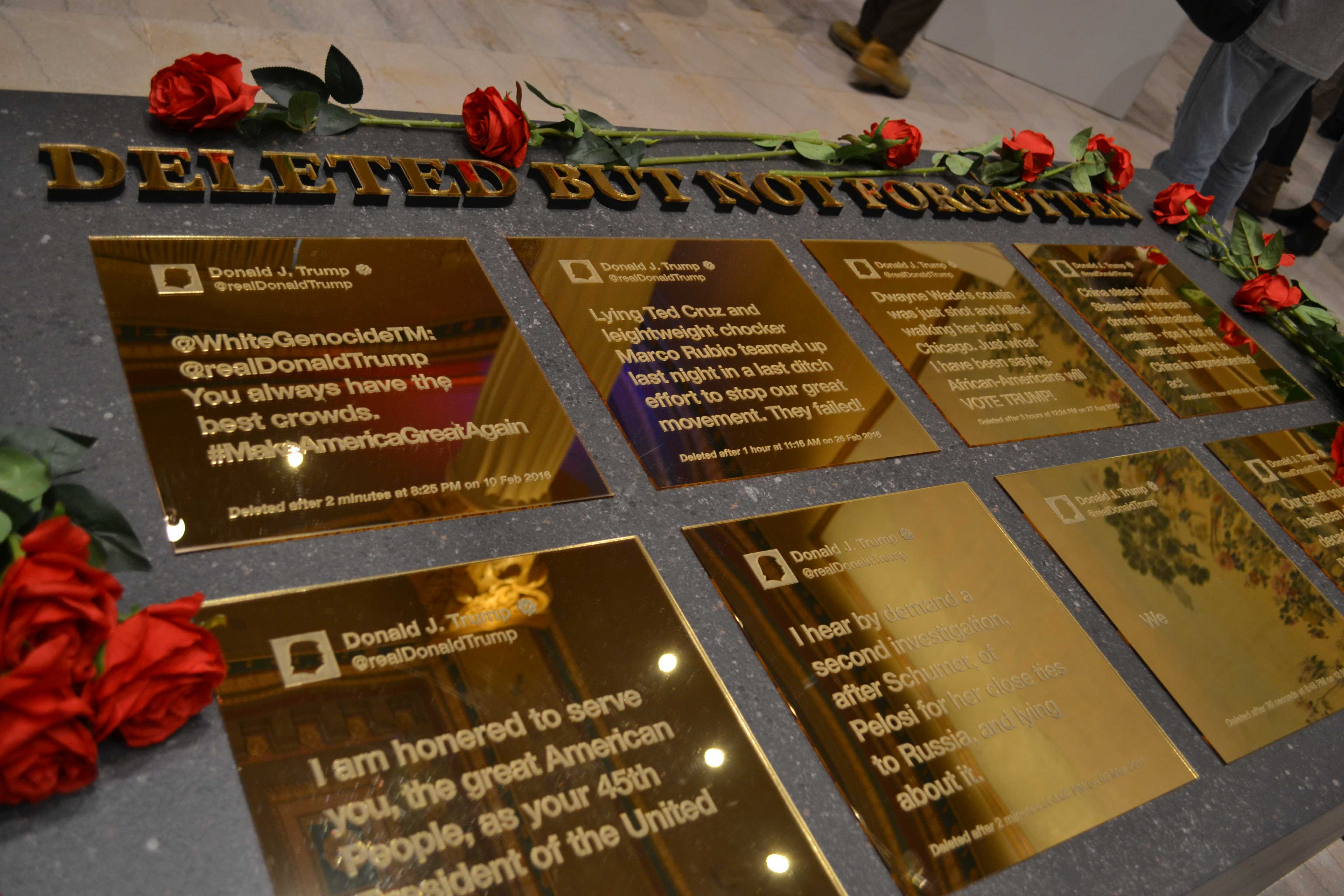 """""""Deleted But Not Forgotten"""" showcases some of President Trump's deleted tweets throughout his presidency, memorialized in gold plaques. (Ben Conboy/The DePaulia)"""