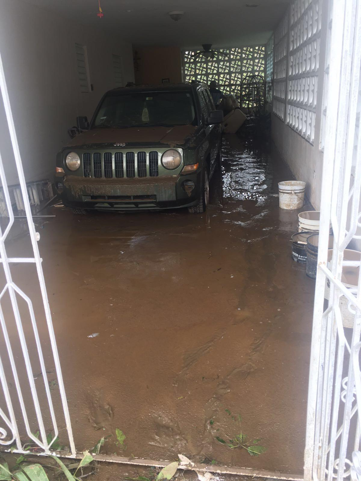 Resident+of+Toa+Baja%2C+Puerto+Rico%2C+Pedro+Col%C3%B3n+Figueroa%27s+truck+is+parked+in+a+flooded+garage.+%0A%28Photo+courtesy+of+Pedro+Col%C3%B3n+Figueroa%29%0A