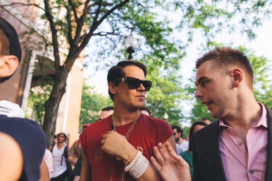 Former Breitbart and right-wing icon Milo Yiannopoulos (left) and John Minster, current president of DePaul College Republicans (right) chat while walking outside in DePaul's Lincoln Park campus following the disrupted Q&A on May 24, 2016. (Josh Leff/The DePaulia)