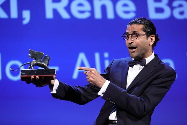 Alireza Khatami accepts his Orizzonti award at Venice Film Festival in September.   (Photo courtesy of Vittorio Zunino Celotto)
