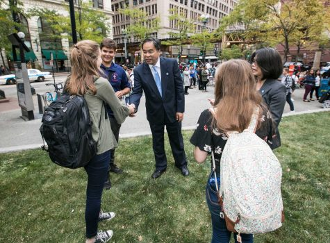 DePaul University President A. Gabriel Esteban, Ph.D., and his wife, Josephine, greet students in Pritzker Park on State Street Wednesday, Sept. 6, 2017.  (Jamie Moncrief/DePaul University)