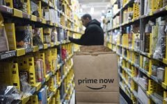 FILE-A clerk picks up items for customer orders at the Amazon Prime warehouse in New York in this Dec. 20, 2017 photo. Amazon announced it has narrowed down  the list for potential sites for a second headquarters in 20 U.S. and Canadian cities.  (Mark Lennihan | AP)