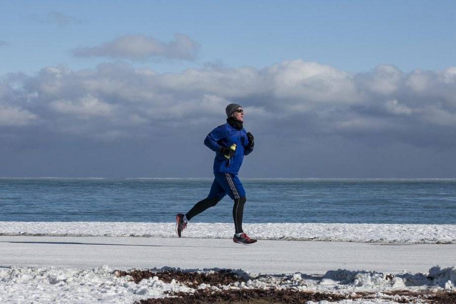 A jogger braves negative temperatures to run along the Lakefront in the frigid early hours of Jan. 4.  (Photo courtesy of Associated Press)