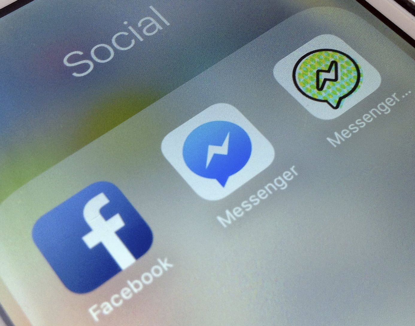 This photo shows application icons from left, Facebook, Facebook Messenger and Messenger Kids on an iPhone.(Photo courtesy of the Associated Press)