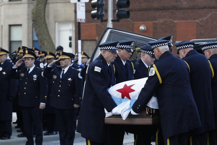Bauer's remains, wrapped in a Chicago flag, are carried into a Bridgeport church by CPD leadership. (Photo courtesy of the Associated Press)