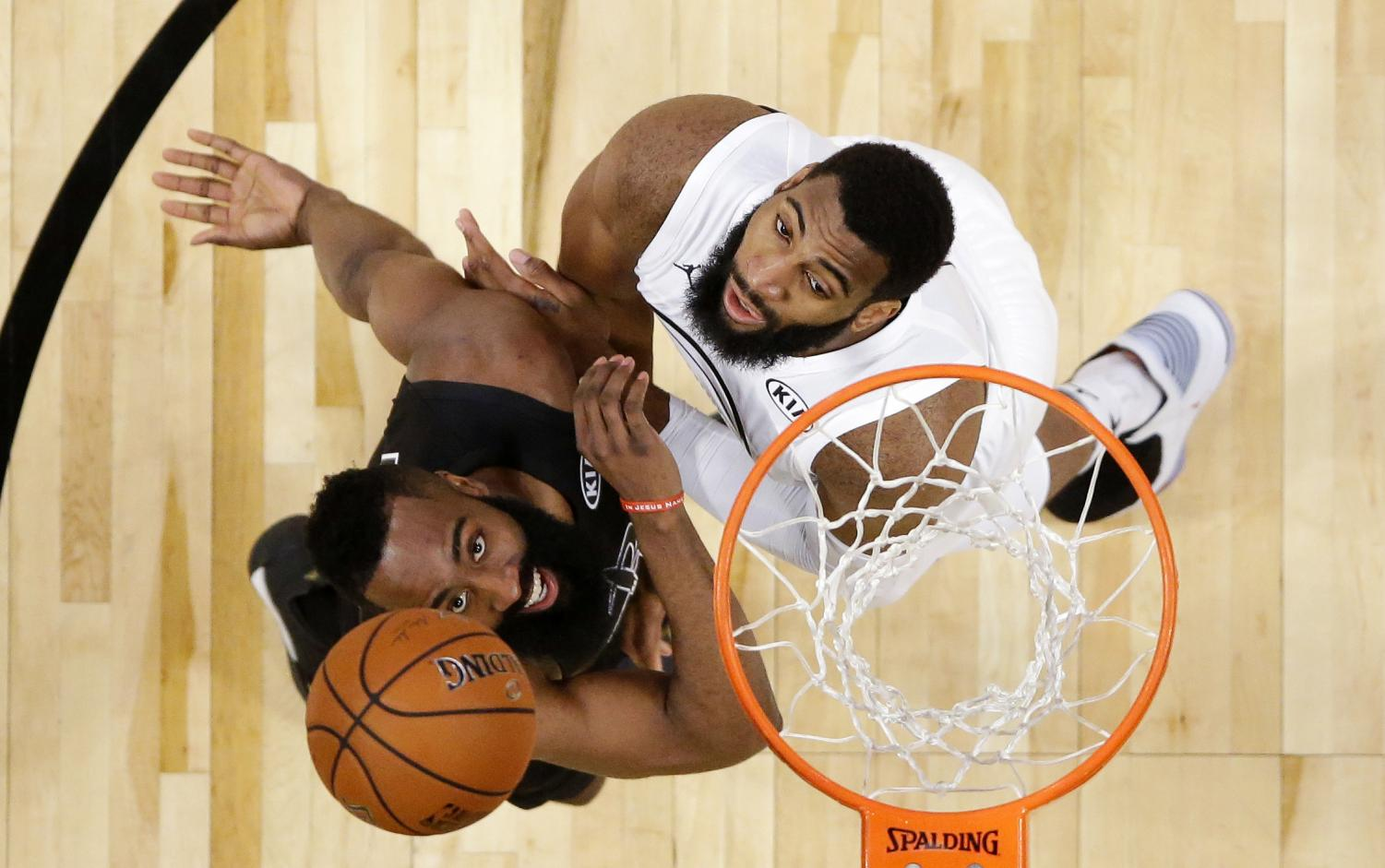 Two players, Team Stephen's James Harden, left, from the Houston Rockets and Team LeBron's Andre Drummond form the Oklahoma City Thunder, go for a rebound in the second half of the NBA All-Star Game on Feb. 18. (Photo courtesy of AP Newsroom)
