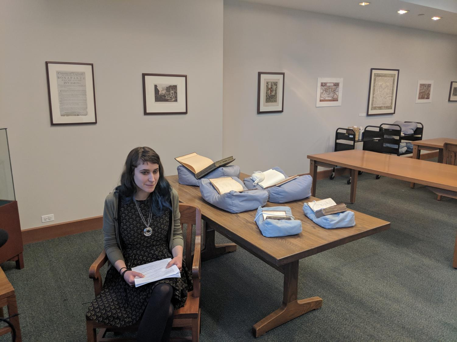 Rare books librarian Nora Gabor shows off the five rarest books in DePaul's collection.  (Jonathan Ballew | The DePaulia)