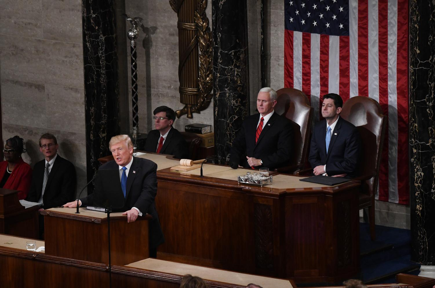 President Donald Trump delivers his State of the Union address, and  Vice President Mike Pence and Speaker of the House of Representatives Paul Ryan sit behind him. (PHOTO COURTESY OF Tribune News Service)
