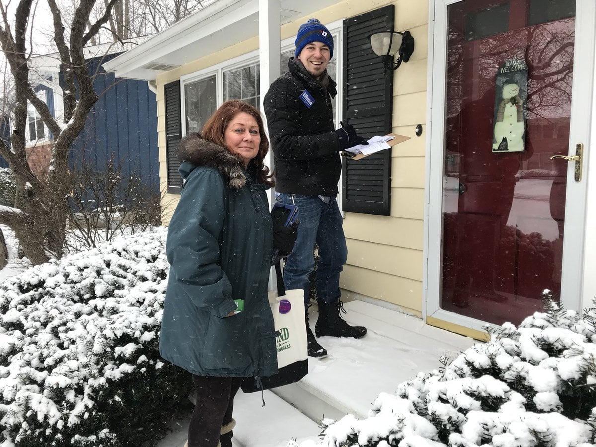 Morrison sports his DePaul beanie while canvassing the 15th District with Democratic congressional candidate Amanda Howland. (Photo courtesy of Kevin Morrison)