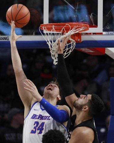 Maric trys to finish a contested layup Saturday hosting No. 1 Xavier in his final home game with the Blue Demons. (Jim Young | AP News)