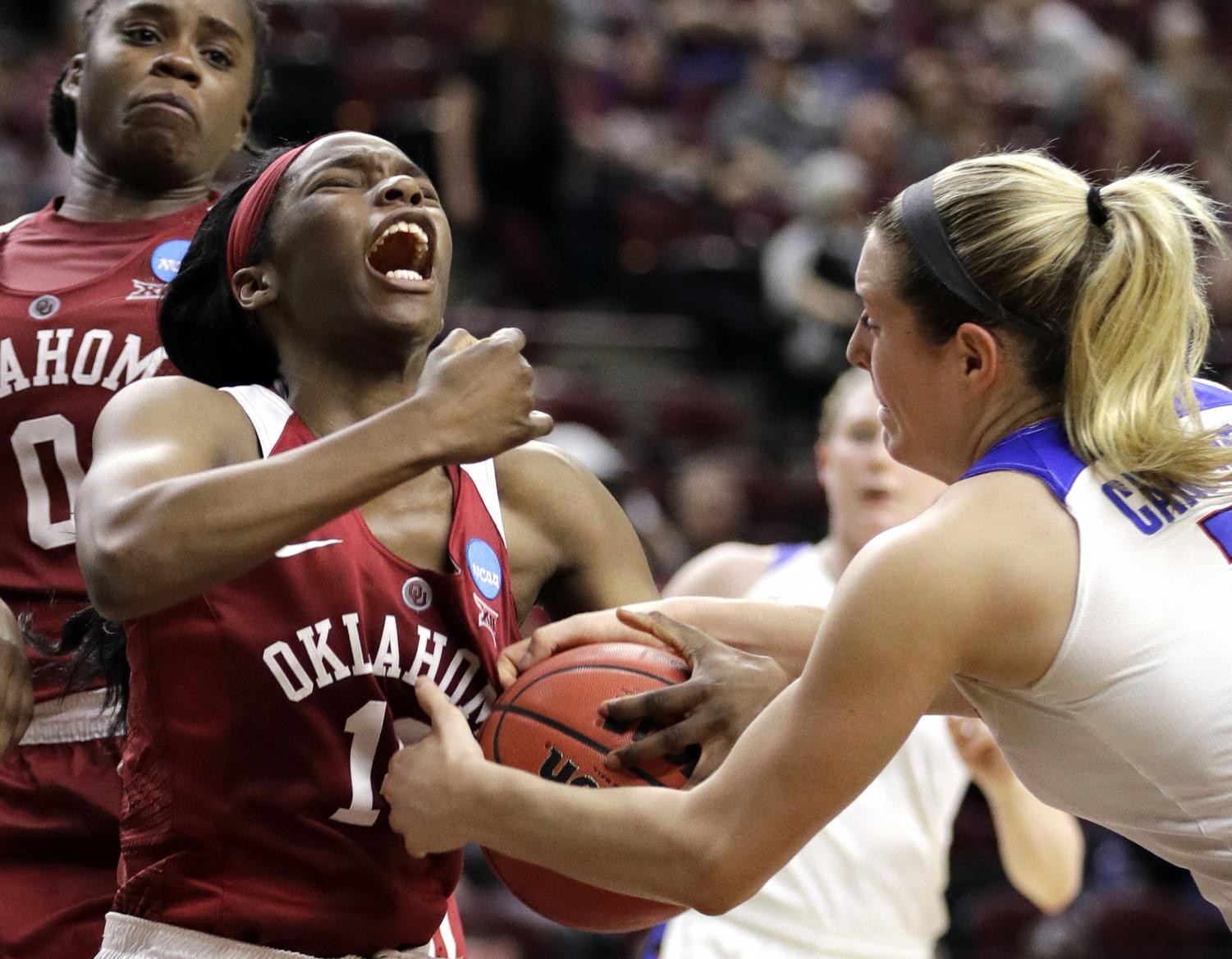 DePaul limited LaNesia Williams (left) to 1-of-9 shooting and two points in the Blue Demons win over the Sooners. David J. Phillip | AP