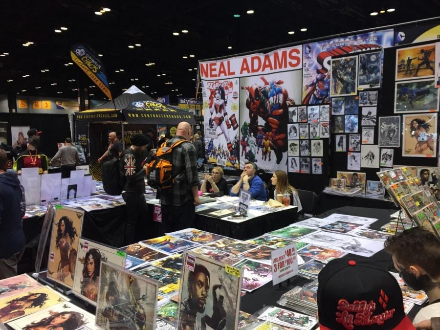 Artist Neal Adams sits at his booth as he signs merchandise and chats with fans about the comic book making process. Brian Pearlman | The DePaulia