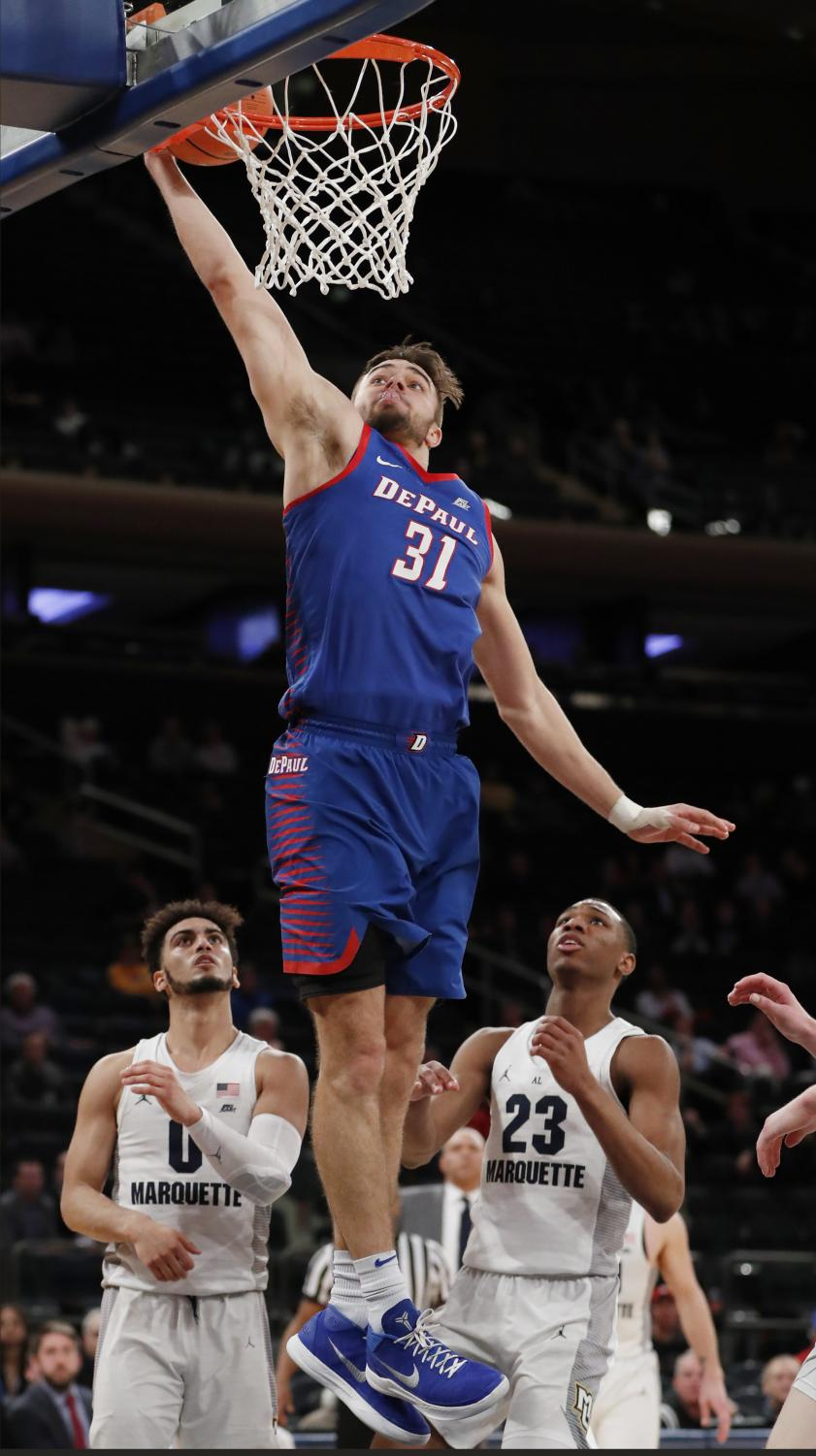 Junior guard Max Strus throws down a dunk in DePaul's first round loss in the Big East Tournament at Madison Square Garden.  (Kathy Willens | AP)