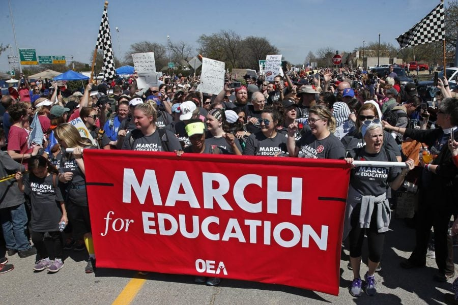 Marchers+cheer+as+they+cross+the+finish+line+at+the+state+Capitol+after+marching+110+miles+from+Tulsa%2C+Okla.%2C+as+protests+continue+over+public+school+funding%2C+in+Oklahoma+City%2C+Tuesday%2C+April+10%2C+2018.%0A%28SUE+OGROCKI+%7C+AP%29