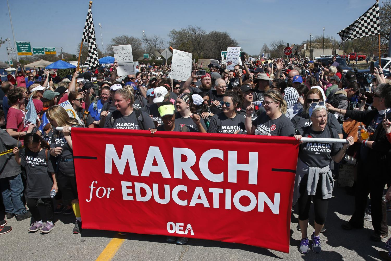 Marchers cheer as they cross the finish line at the state Capitol after marching 110 miles from Tulsa, Okla., as protests continue over public school funding, in Oklahoma City, Tuesday, April 10, 2018. (SUE OGROCKI | AP)