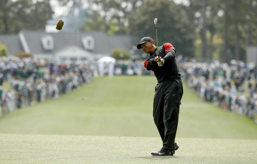 Tiger Woods opens with a par during the final round of the 2018 Masters. (Charlie Riedel | AP)