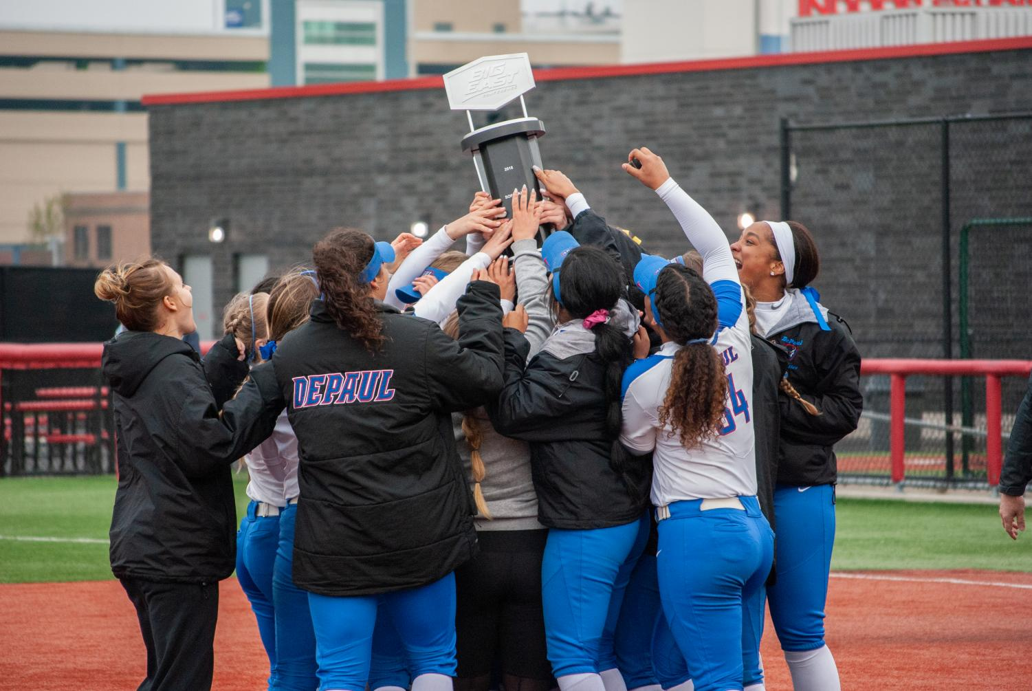 DePaul's softball team celebrates in the pitching circle at The Ballpark in Rosemont, Illinois Saturday after winning a second-straight title.