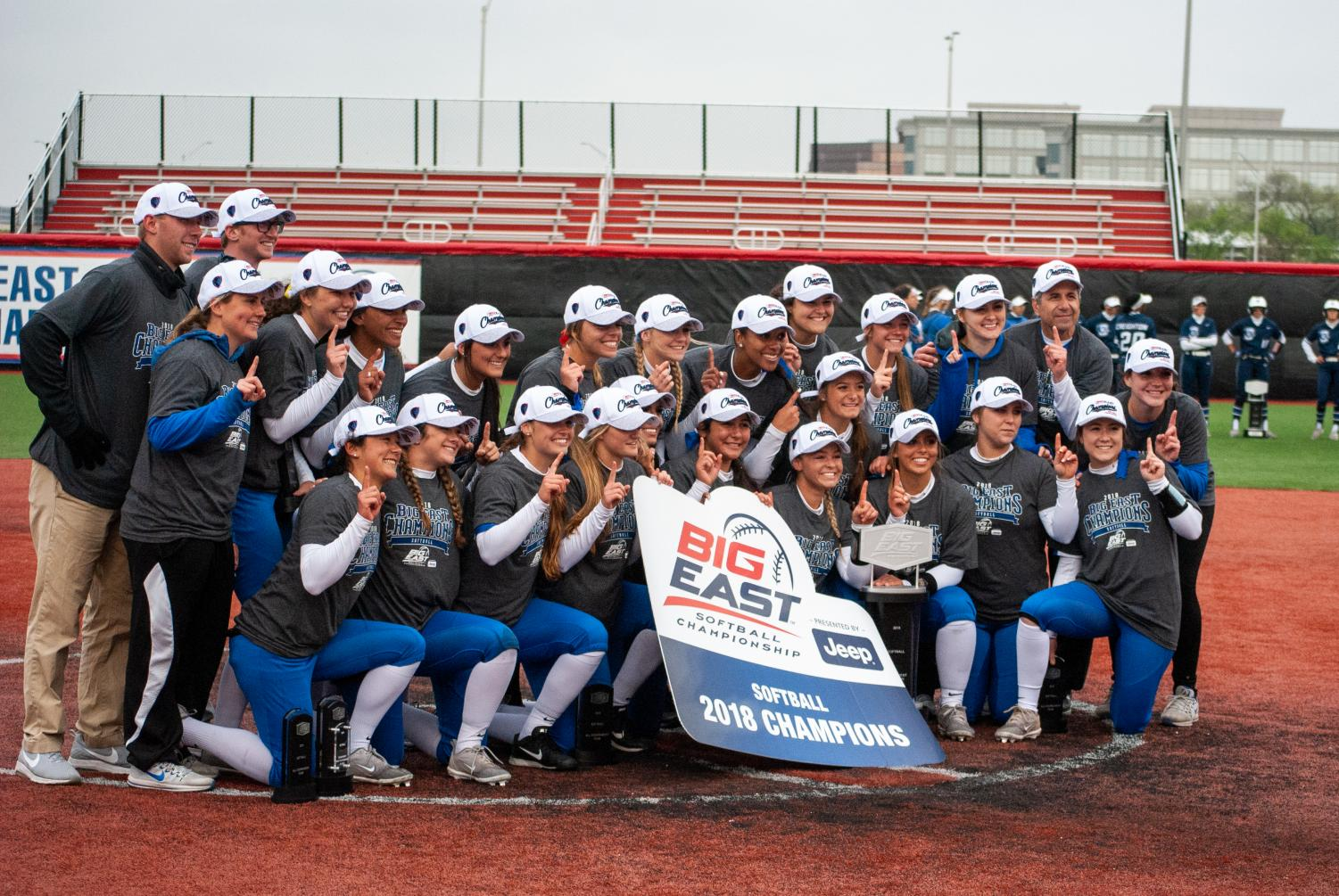 DePaul softball celebrates their 2018 Big East Tournament title. The Blue Demons won their third straight Big East Tournament title against Villanova on Saturday in Rosemont.