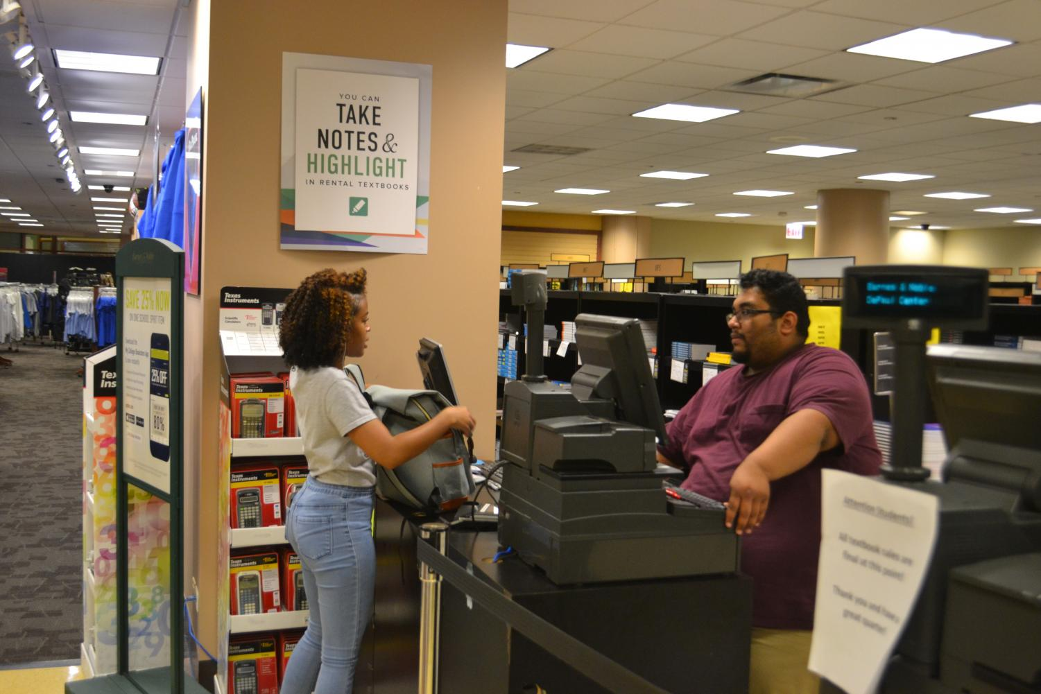 A DePaul student conducts a transaction at DePaul's Loop Campus bookstore. Many students have advocated for open source textbooks due to pricing.