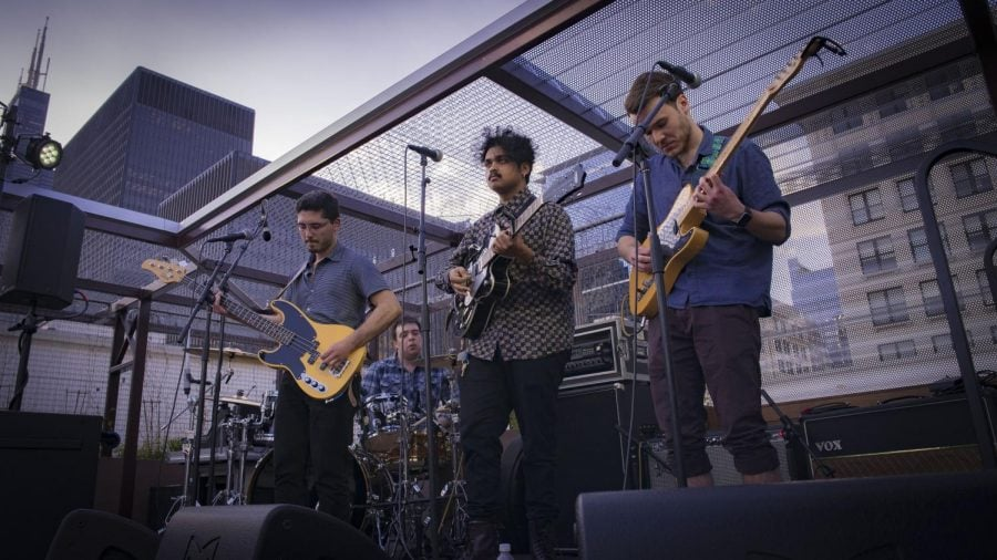 Five-piece band Books was one of four local bands that played amongst the skyscrapers leading up to the much anticipated artist reveal for this year's FEST. (Photo courtesy of Matt Bordman)