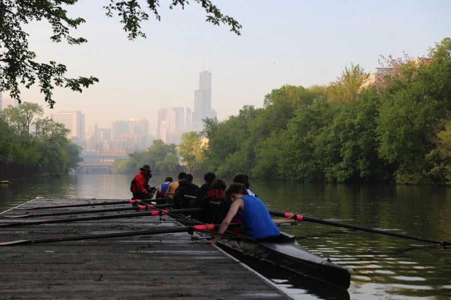 DePaul's six-year-old crew club gathers into their 60-foot boat and pushes off the dock for practice along the Chicago River.