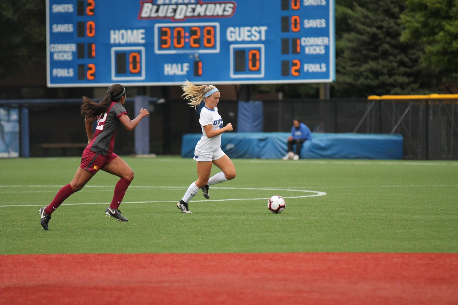 Senior Franny Cerny races past Loyola midfielder Abby Swanson while picking up an assist for DePaul's only goal in a 1-0 win.  Xavier Ortega | The Depaulia