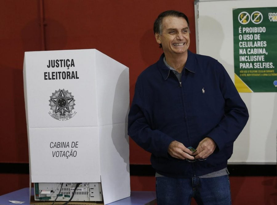 Jair+Bolsonaro%2C+presidential+candidate+with+the+Social+Liberal+Party%2C+smiles+after+voting+in+general+elections+in+Rio+de+Janeiro%2C+Brazil%2C+Sunday%2C+Oct.+7%2C+2018.