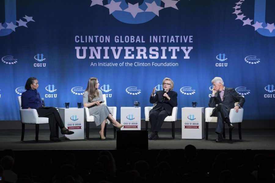 Helene Gayle (left) interviews Chelsea Clinton, Hillary Rodham Clinton, and President Bill Clinton at a discussion Saturday at the University of Chicago.