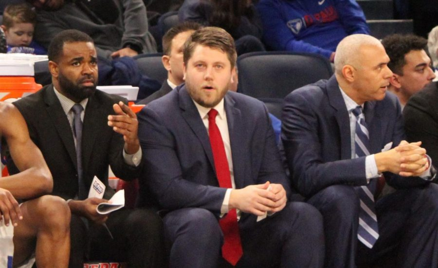 DePaul assistant coaches Tim Anderson and Shane Heirman sit next to DePaul head coach Dave Leitao.