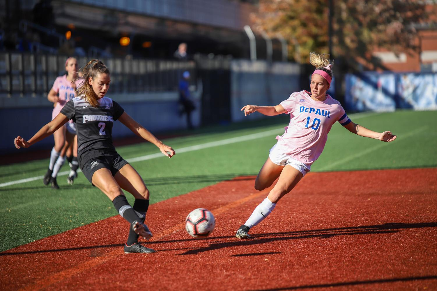 DePaul forward Franny Cerny and Providence defender Hailee Duserick fight for the ball on Thursday at Wish Field. The Demons tied Providence 0-0 in double OT. Mairead Khan  | The DePaulia