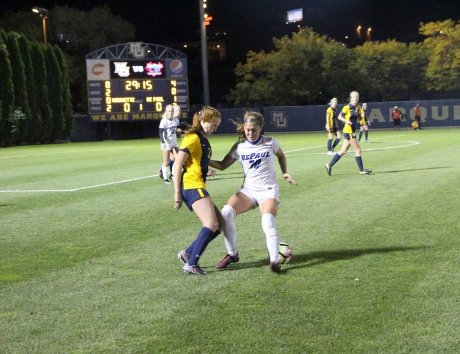 DePaul sophomore forward Jade Erikson-Russo tracks down Marquette senior forward Carrie Madden during the first half of DePauls 0-0 draw with Marquette.