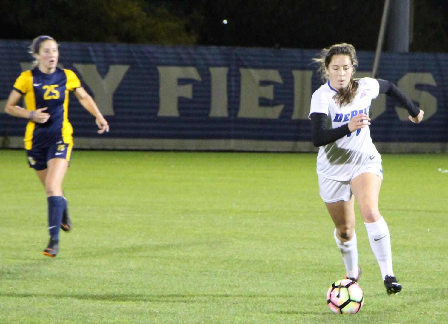 DePaul senior midfielder Madeline Frick controls the ball as Marquette senior midfielder Leah Celarek looks on during the first half of a 0-0 tie between DePaul and Marquette.  Andrew Hattersley | The DePaulia