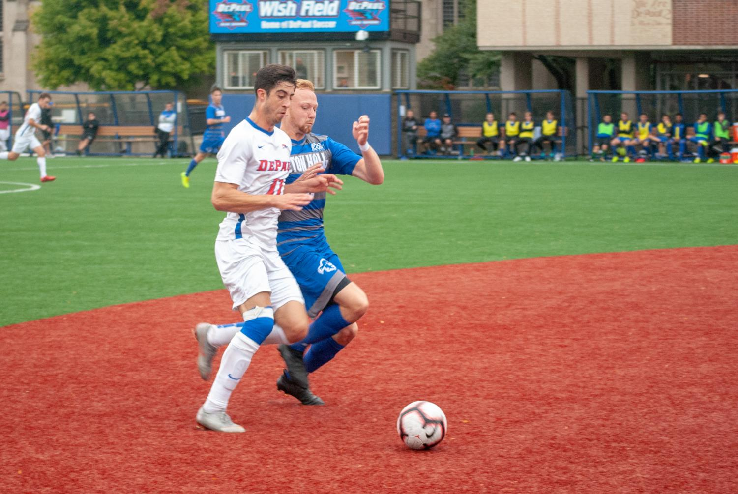 Junior midfielder Zach El-Shafei battles Seton Hall sophomore defender Love Fredriksson during DePaul's 1-1 tie with Seton Hall.  Jonathan Aguilar | The DePaulia